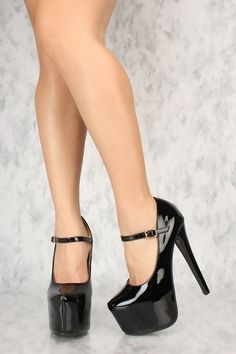 The featuring includes a bold color with a faux leather material, center buckle strap, scoop vamp, almond close toe, followed by a cushion foot-bed and a smooth finished touch. Approximately 6 inch heel and 2 inch platform.