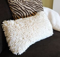 Throw pillows made from throw bathroom mats!  Amazing & simple-especially the hand sewn ones.