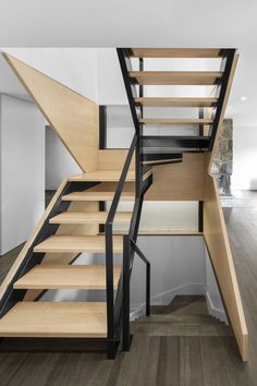Canadian architecture firm Naturehumaine has recently refurbished a 1960s family house, called Closse Residence, adding large glazed doors and a new sculptural staircase.