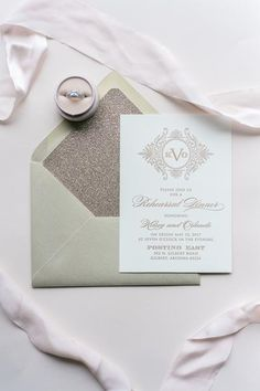 Luxe Pocket Rehearsal Dinner Invitation for Any Suite! Foil stamped jacket invitation with glitter envelope liner. Available in all kinds of colors, but shown here in champagne and gold. Letterpress, foil, digital