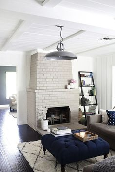 Gray brick fireplace and neutral + navy living space