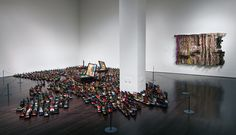 El Anatsui | Open(ing) Market (2004), which is placed on the floor and metal work on the wall called Zebra Crossing III (2007).