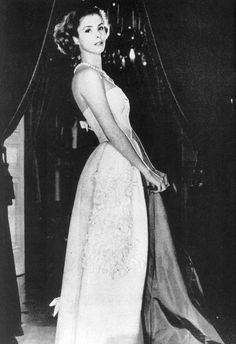 Dolores Guinness wearing an evening gown by Christian Dior.  Photo by Henry Clarke at the Paris apartment of her mother (Gloria).  Vogue, 1957.