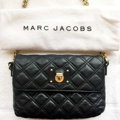 "Marc Jacobs Small Quilted Crossbody Bag Perfect everyday bag. Black quilted cow leather with gold hardware. Very versatile, can be worn during the day and worn as a clutch at night! In great preloved condition. Used a handfull of times. Leather has softened due to use. Pls check out photos for reference.       Strap Type: Chain Strap Flat Measurements: 5""X 8""X 1.5"" Closure: Snap  Feature : Single chain shoulder strap  Feature : Front flap with magnetic closure  Feature : Inner zip pocket…"