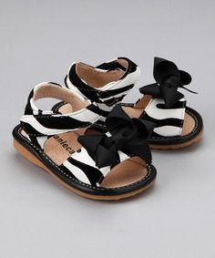 Take a look at this Zebra Bow Squeaker Sandal  by Laniecakes on #zulily today!