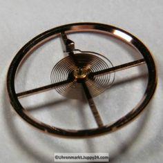 Omega Unruh Spirale Welle komplett montiert Cal. 550 – 551- 552 – 560