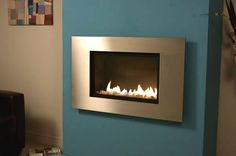 hole in the wall ribbon gas fire with Stainless Steel Trim. The fire is operated by a manual control which is hidden behind the fascia keeping the sleek look of the fire. Wall Gas Fires, Flueless Gas Fires, Wall Mounted Fireplace, Fire Basket, Blue Walls, Traditional Design, The Creator, New Homes, Modern