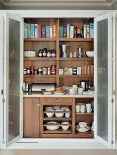 Grey bi fold kitchen cupboard doors reveal wooden shelving inside a larder cu - Armoire de rangement castorama ...