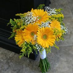 Yellow Gerbera Daisy Bouquet, not with the yellow filler, too weedy looking, wrapped in burlap for girls, mint green dresses