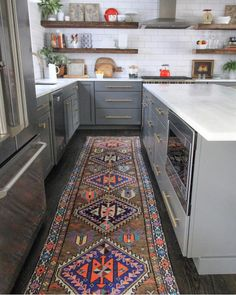 This weeks favorites are up on the blog today!! Came across this pic last night and this rug Kitchen with Gray cabinetry, open shelving, and vintage runner
