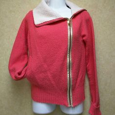*HP* Rocawear sweater jacket Lovely coral/pink sweater jacket with fleece collar.  Acrylic/wool blend knit.  Zipper is gold color.  Zipper pull is RW logo with rhinestones inset. Back is beautifully decorated with rhinestones and gold tone studs.  One pocket.  Very unique sweater jacket is gently worn but in good shape. Rocawear Jackets & Coats