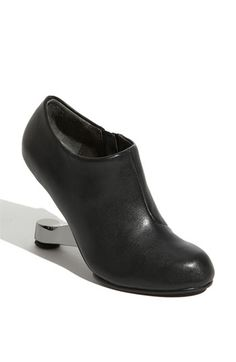 hmmm, I am thinking I wouldn't be able to walk in these... interesting heel though!