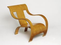 Armchair | Designed by Gerald Summers in Great Britain, 1934 | Manufacturer: Makers of Simple Furniture | Material: Seven layers of plywood moulded in a single sheet | The Makers of Simple Furniture was a short-lived company run by the designer Gerald Summers during the 1930's. It produced innovative designs which exploited the strength of plywood | This chair was inspired by Alvar Aalto's bent plywood chairs of the same decade | VA Museum, London