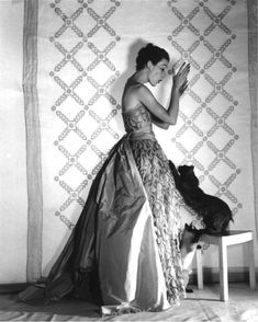 Louise Dahl-Wolfe, Mary Jane Russell in a Balenciaga Gown With Cat