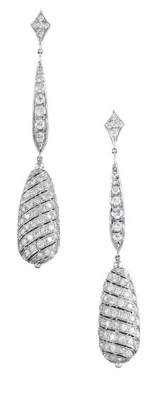 Dramatic Pave Diamond Three-Inch White Gold Dangle Earrings. Three inch long diamond drop earrings, forged in platinum and set with 6.50 carats of brilliant diamonds. The stones grade I-J color and Vs clarity. Clearly inspired by the ionic designs of the art deco era, but likely not quite that old.