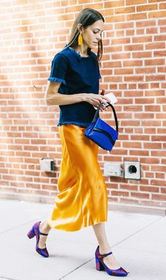 Blue top, mustard silky skirt and print mary janes.
