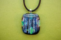 Dichroic glass pendant black, green, and blue patterned from Ivy Tree Designs. $18.60