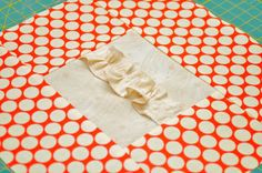 Close up Block type:log cabin Block size:11 inches Colour scheme:reds and neutrals Texture/fabric manipulation:gathered double-edged ruffle Quilt size:The finished quilt is 52 ½ x 52 ½. Needs:...