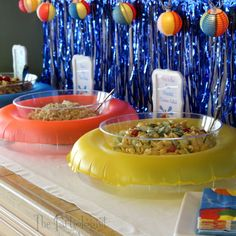 The Partiologist-Pool Party! Cute buffet table set up with small float rings
