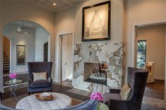 919 Clearbrook Ln Houston, TX 77057: Photo ..and features a dramatic double sided fireplace between the formal living area and the..