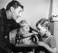 Robert Mitchum spending time with his sons Chris and James