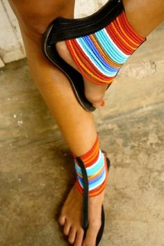 Produced by Leen Samyn in cooperation with a local Maasai Women's group. Experience the feeling of being comfortable and sexy at the same time in this unique finely crafted leather and beaded sandal. Cute Sandals, Cute Shoes, Me Too Shoes, Beaded Shoes, Beaded Sandals, Stilettos, Heels, Crazy Shoes, African Accessories