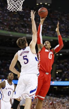 Jeff Withey getting one of his 7 blocks in the game against Ohio State.  The Kansas Jayhawks won, thanks in large part to Withey's outstanding play.  Now they move on to play for the National Championship on Monday.