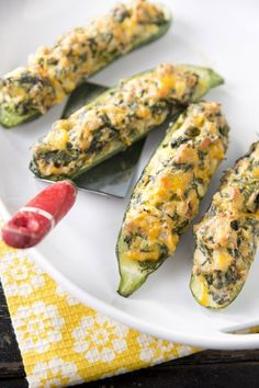 My family loves these, I use goat cheese in place of sour cream and add fresh garlic. Also brush with olive oil or butter before I put in oven! Paula Deen Spinach Stuffed Zucchini http://www.pauladeen.com/spinach-stuffed-zucchini