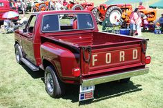 1985 Ford F-150 XL Flareside -            **Bonus** tractors in the background .