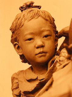 Over life size bronze figure of Korean educator Lee Won Hee with her grandchildren is located in Kyonggi Elementary School in Seoul, Korea.