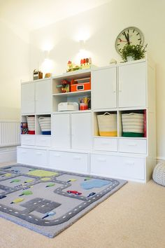 Playroom storage that looks and feels bespoke This playroom storage range gives you the look and durability of built-in storage without the cost! Simply pick the units you like and stack them up to make the most of any space, large or small. Diy Understairs Storage, Corner Storage, Modular Storage, Playroom Organization, Built In Storage, Wall Storage, Organization Ideas, Living Room Playroom, Modern Playroom