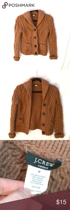 """J. Crew Handknit Shawl Sweater Cardigan (M) A warm handknit shawl cardigan by J. Crew. It features a generous collar that can be flipped up for extra warmth, two exterior pockets, fold-back cuffs, and 4 big buttons. The natural camel hair color is vibrant and interesting, perfect to pair with jeans on a cold day.Has signs of wear but good condition.  40% Merino Wool, 30% Viscose, 20% Angora Rabbit Hair, 10% Cashmere   Size is medium but runs a little small. Underarm to underarm 16"""".  #…"""