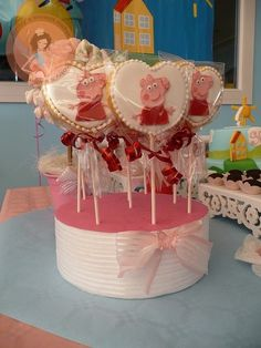 Heart shaped cookie pops from a Peppa Pig Birthday Party!  See more party ideas at CatchMyParty.com!  #partyideas #pig