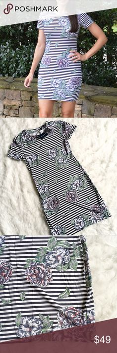 French Connection Bonita Trail Floral Stripe Dress French Connection tends to run small. The brand suggests ordering one size up from your normal size. Parisian loveliness is in bloom in this French Connection™ Bonita dress. Stretch-cotton body con dress is covered throughout with horizontal stripes and artistically drawn flowers. Jewel neckline buttons closed at the nape of neck. Short sleeves. Straight hemline. Unlined. 95% cotton, 5% Lycra® French Connection Dresses Mini
