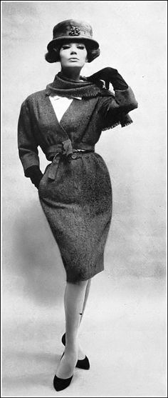 Simone in brown wool tweed suit, jacket is short and collarless worn over white shirt, narrow skirt is softly gathered at the waist, matching scarf, by Balenciaga, photo by Richard Avedon, Harper's Bazaar, November 1959