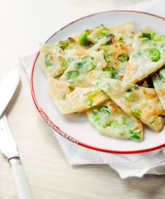 Chinese spring onion pancakes serve with a drizzle of Sriracha