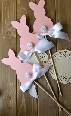 Our Bunny Centerpiece Sticks are the perfect addition to your Bunny Party Decor! They are handcrafted with card stock and hand rolled flowers and will look darling on your party table! Stick them in mason jars, flower arrangements or your candy bar and they will add that extra bit of