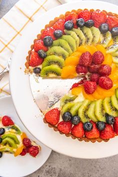 An image of a classic French fruit tart with strawberries, kiwi, mandarin oranges, blueberries and raspberries arranged on top. French Fruit Tart Recipe, Fruit Tart Glaze, Easy Fruit Tart, Fresh Fruit Tart, Fruit Tarts, Easy Tart Recipes, Fruit Recipes, Dessert Recipes, Nutella Recipes