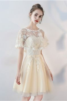 Shop Champagne Tulle Short Party Dress with Lace Cape Sleeves online. SheProm offers formal, party, casual & more style dresses to fit your special occasions. Grad Dresses Long, Purple Bridesmaid Dresses, Girls Pageant Dresses, Junior Bridesmaid Dresses, Dressy Dresses, Party Wear Dresses, Wedding Dresses, Homecoming Dresses, Gowns Of Elegance