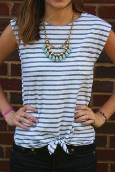 Hi, everyone! Today, I have a DIY for you all--a tank top made from an old t-shirt!  Every summer, I go out and buy at least a few tanks for... Knotted Shirt, Tied T Shirt, Tie Tshirt Knot, Tie Front Shirt, Sew Tshirt, Front Tie Top, Tanks, Tank Tops, T Shirt Remake