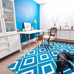 #DIY #rug- paint a cheap IKEA rug with your leftover paints for a fun geometric pop of color. Awesome.