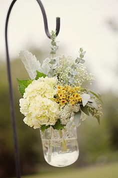 Love these for the ceremony aisle, flowers in mason jars