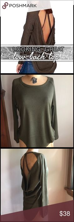 Low-Back Strappy Top Low-Back Strappy Top; low cowl-style back; strap detail on back; ribbed material; Tunic length in from and back with shorter sides; cotton/poly blend; Please examine all pictures prior to purchasing.  @A1 Boutique Tops