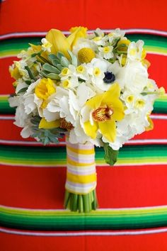 bright and festive bouquet; this one features in-season spring flowers like daffodils and narcissus