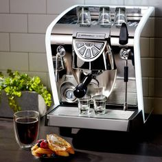 Combining beautiful form and function, the Nuova Simonelli Musica is a professional-grade espresso machine that lets you make coffee-bar-caliber beverages at home with ease.  This Lux version also features white LED-lit edging for a bright, modern touch.