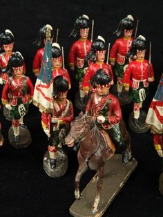 Scottish Highlander toy soldiers. The detail is great on these antiques.