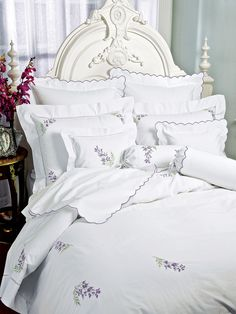 Wisteria Bed Collection - Luxury Bed Sheets - As though plucked from a prized vine, the full beauty of wisteria is reproduced in exquisite hand embroidery on superior 600 thread count, pure White Egyptian cotton sateen woven in Italy