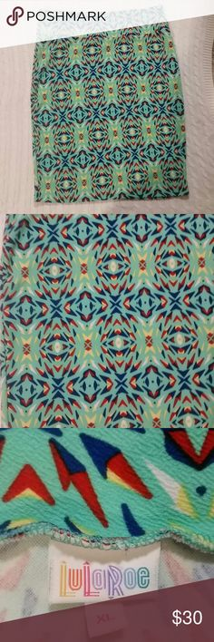 Lularoe Cassie pencil skirt only worn a few times Lularoe Cassie pencil skirt mint green, blue, red, yellow and white super fun design!  Only selling because it no longer fits. LuLaRoe Skirts Pencil