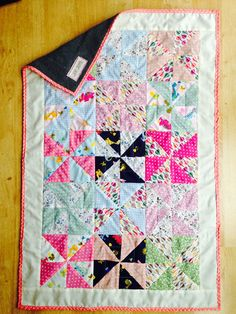 Complete. Small blanket for a baby girl. Windmill patchwork design from fat quarters, quilted with single layer of fleece, home-made binding.