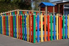 wood picket playground child safety fencing painted like crayons/colored pencils